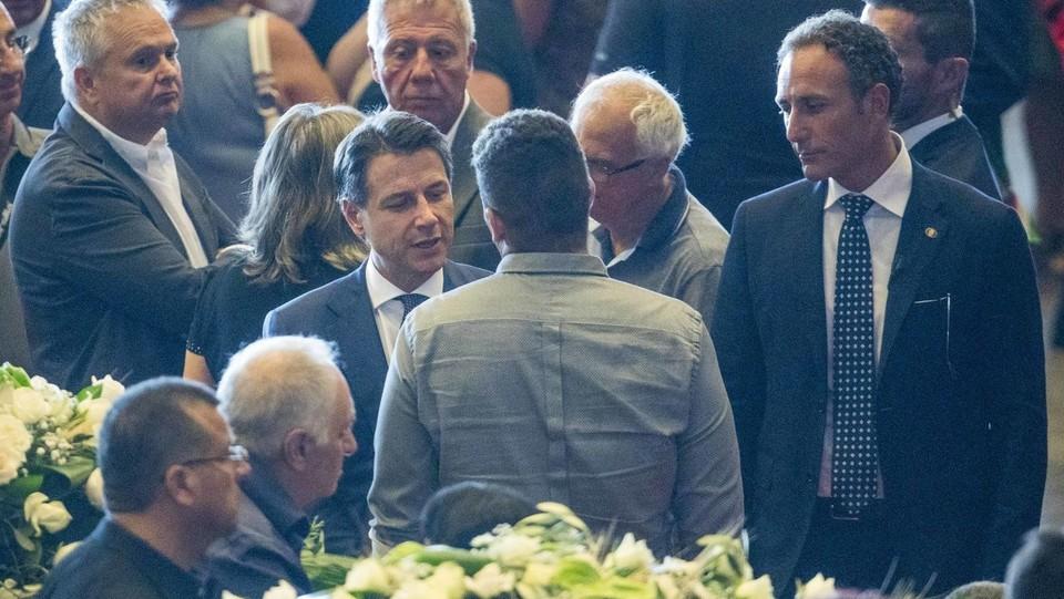 Il premier Conte con i parenti delle vittime ©Mauro Ujetto/LaPresse