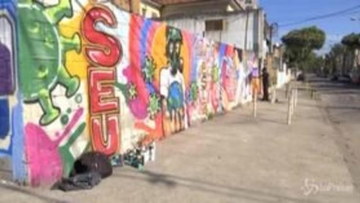 Coronavirus, Brasile: un artista dedica un murale agli operatori sanitari