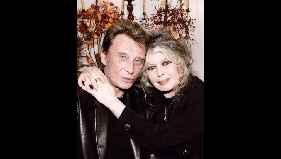 Brigitte Bardot con il cantante Johnny Hallyday nel 2004 ©