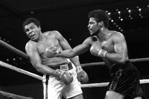 Leon Spinks, right, connects with a right hook to Muhammad Ali